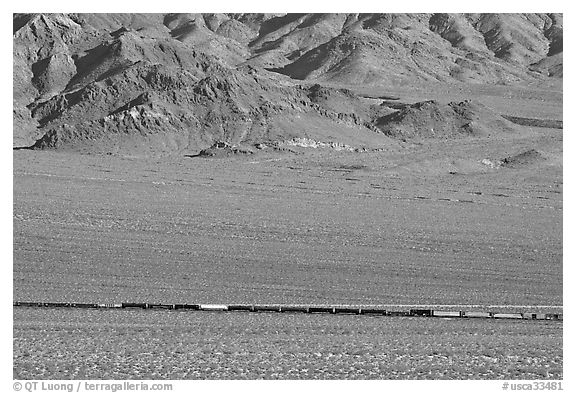 Freight train in desert valley. Mojave National Preserve, California, USA (black and white)