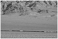 Freight train in desert valley. Mojave National Preserve, California, USA ( black and white)