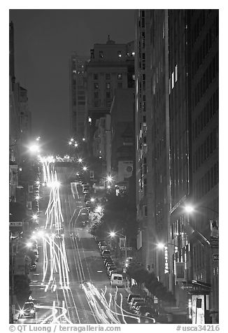 Steep California street and lights at night. San Francisco, California, USA (black and white)