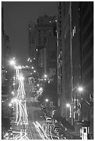 Steep California street and lights at night. San Francisco, California, USA ( black and white)
