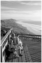 Enjoying sunset from the observation platform at Fort Funston. San Francisco, California, USA ( black and white)