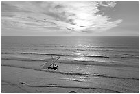 Hang glider flying  above ocean, Fort Funston, sunset. San Francisco, California, USA ( black and white)