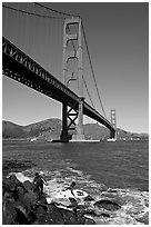 Surfers below the Golden Gate Bridge. San Francisco, California, USA (black and white)