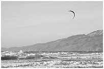 Kite surfer in Pacific Ocean waves, afternoon. San Francisco, California, USA ( black and white)