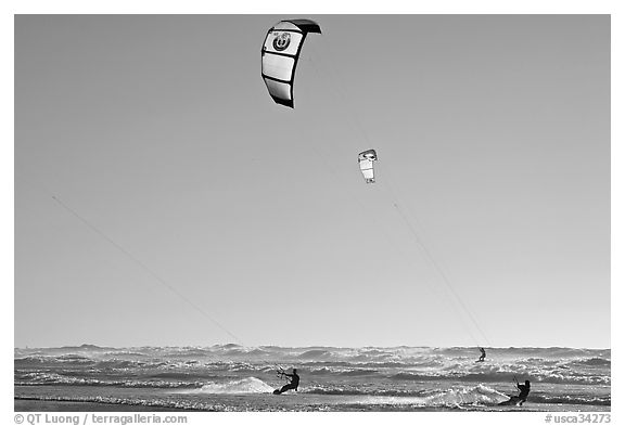 Kite surfers and Pacific Ocean waves, late afternoon. San Francisco, California, USA (black and white)