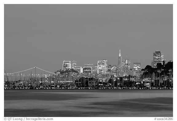 Sausalito houseboats and San Francisco skyline at night. San Francisco, California, USA (black and white)