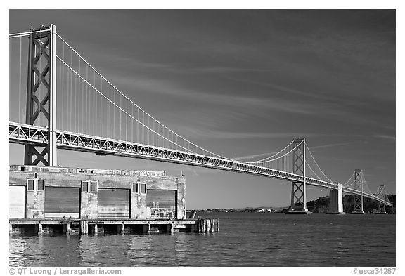 Old pier and Bay Bridge, early morning. San Francisco, California, USA (black and white)