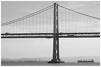 Traffic on Oakland Bay Bridge and tanker ship. San Francisco, California, USA (black and white)