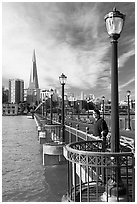 Visitor standing on pier 7, morning. San Francisco, California, USA ( black and white)