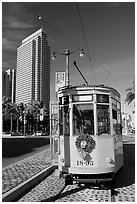 Historic trolley car and Embarcadero center building. San Francisco, California, USA ( black and white)