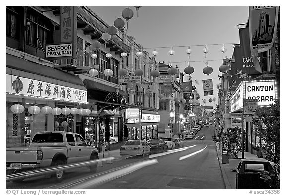 Lanterns and lights on Grant Street at dusk, Chinatown. San Francisco, California, USA