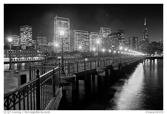 Embarcadero and Transamerica Pyramid seen from Pier 7 at night. San Francisco, California, USA (black and white)
