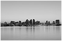 Skyline reflected in the waters of harbor, dawn. San Diego, California, USA (black and white)
