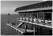 Restaurant at the edge of harbor. San Diego, California, USA (black and white)