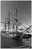 Maritime Museum with HMS Surprise and ferryboat Berkeley. San Diego, California, USA (black and white)