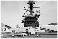 Navy aircraft and island superstructure, USS Midway. San Diego, California, USA (black and white)