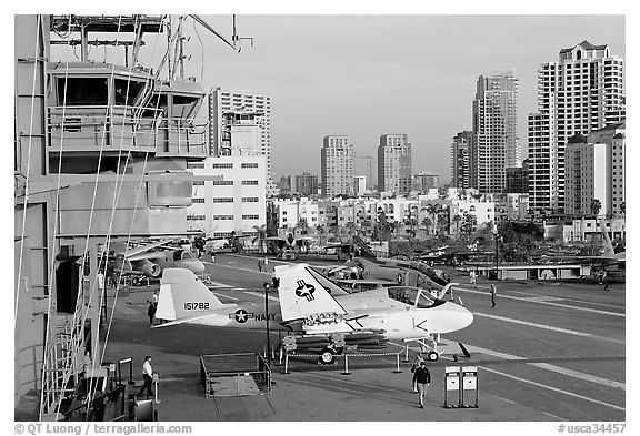Flight control tower, aircraft, San Diego skyline, USS Midway aircraft carrier. San Diego, California, USA (black and white)