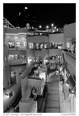 Some of the 140 stores in the Horton Plaza shopping mall at night. San Diego, California, USA (black and white)