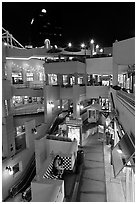 Some of the 140 stores in the Horton Plaza shopping mall at night. San Diego, California, USA ( black and white)