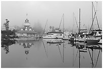 Boats and historic Coronado boathouse in fog. San Diego, California, USA (black and white)