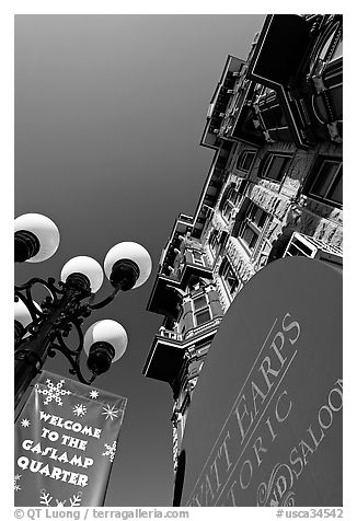 Gaslamp, signs, and facade of the Louis Bank of Commerce, Gaslamp quarter. San Diego, California, USA (black and white)