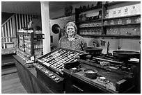 Woman standing behind counter of apothicary store, Old Town. San Diego, California, USA ( black and white)