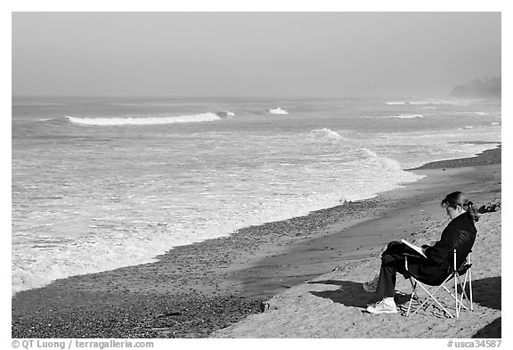 Woman reading on the beach. La Jolla, San Diego, California, USA