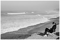 Woman reading on the beach. La Jolla, San Diego, California, USA ( black and white)
