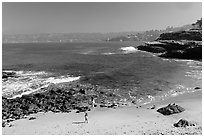 Girls on beach, the Cove. La Jolla, San Diego, California, USA ( black and white)