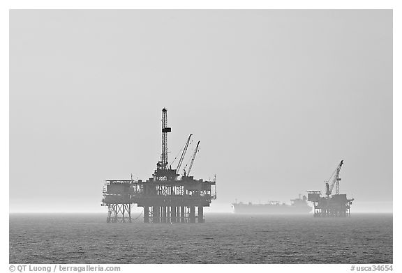 Off-shore drilling platforms and tanker. Huntington Beach, Orange County, California, USA (black and white)