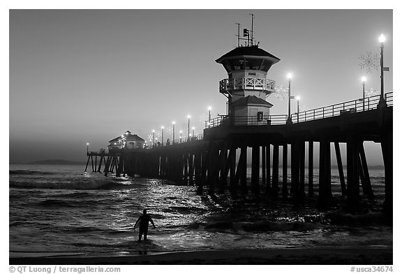 Black And White Picture Photo Surfer Entering Water Next To The Huntington Pier Sunset Beach Orange County California USA