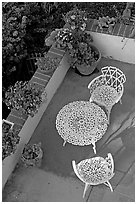 Garden chairs and table seen from above. Laguna Beach, Orange County, California, USA ( black and white)