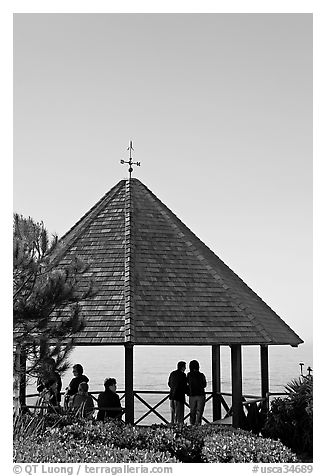 People standing in a Heisler Park Gazebo. Laguna Beach, Orange County, California, USA