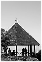 People standing in a Heisler Park Gazebo. Laguna Beach, Orange County, California, USA ( black and white)