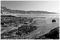 Tidepools and Main Beach, mid-day. Laguna Beach, Orange County, California, USA (black and white)