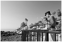 Painter working from an overlook. Laguna Beach, Orange County, California, USA (black and white)