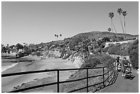 Women pushing babies in strollers in Heisler Park, above Picnic Beach. Laguna Beach, Orange County, California, USA (black and white)