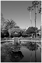 Palm trees reflected in central  courtyard basin. San Juan Capistrano, Orange County, California, USA (black and white)