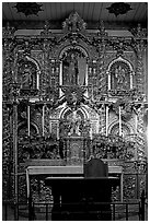 350 year old retablo made of hand-carved wood with a gold leaf overlay. San Juan Capistrano, Orange County, California, USA (black and white)