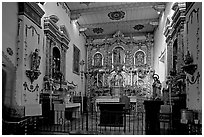 Altar and baroque retablo in the Serra Chapel. San Juan Capistrano, Orange County, California, USA (black and white)