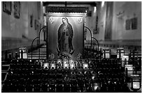 Candles and  Serra Chapel. San Juan Capistrano, Orange County, California, USA ( black and white)