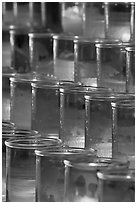 Red candles in glass, sharp. San Juan Capistrano, Orange County, California, USA ( black and white)