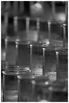 Candles in red glass, background blurred. San Juan Capistrano, Orange County, California, USA ( black and white)