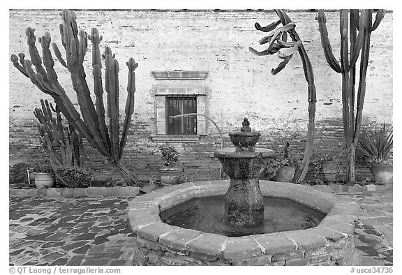 Sacred Garden, with fountain and cacti. San Juan Capistrano, Orange County, California, USA (black and white)