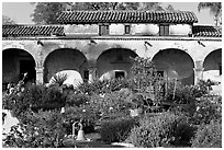 Garden and south wing arches. San Juan Capistrano, Orange County, California, USA (black and white)