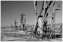 Oil extracting machinery, Chevron field. California, USA ( black and white)