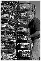 Man loading crab traps. Morro Bay, USA (black and white)