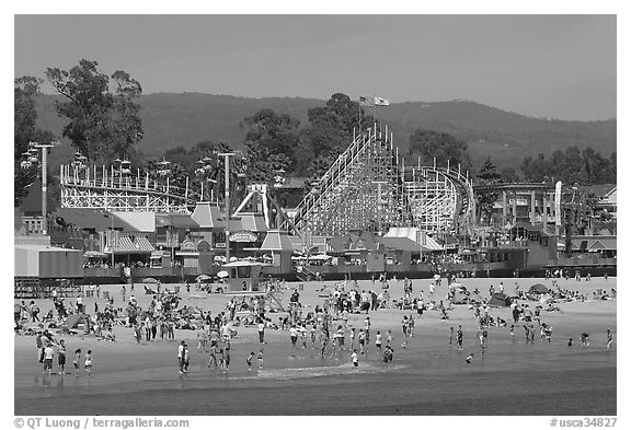 Beach and boardwalk in summer, afternoon. Santa Cruz, California, USA (black and white)