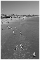 Children playing on the beach. Santa Cruz, California, USA ( black and white)