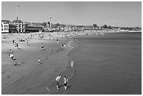 Beach with couple standing in water. Santa Cruz, California, USA (black and white)